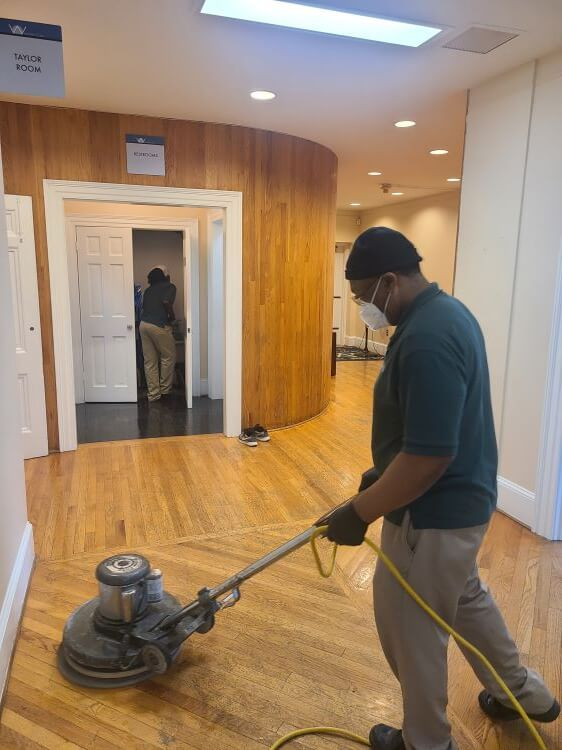 Cleaning entrance floor.