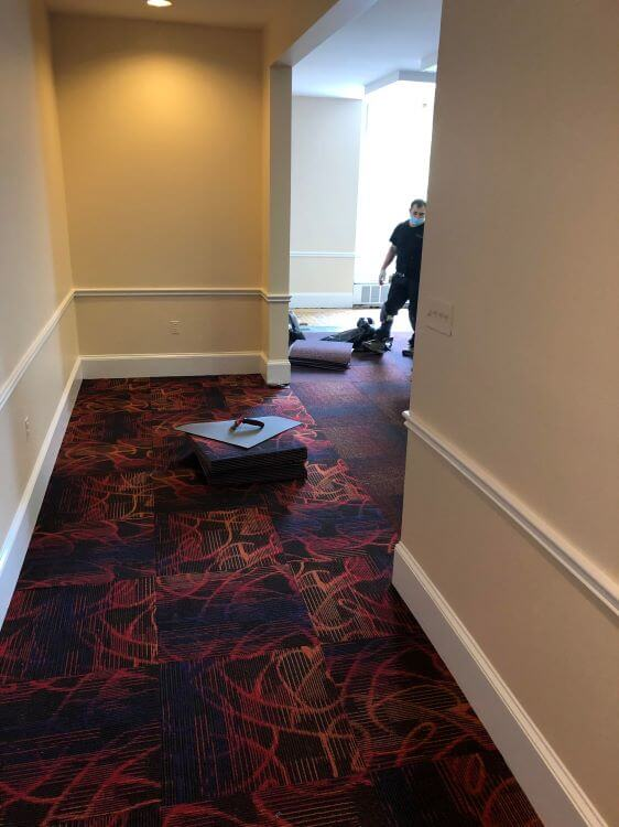 Carpet install in Taylor Room.
